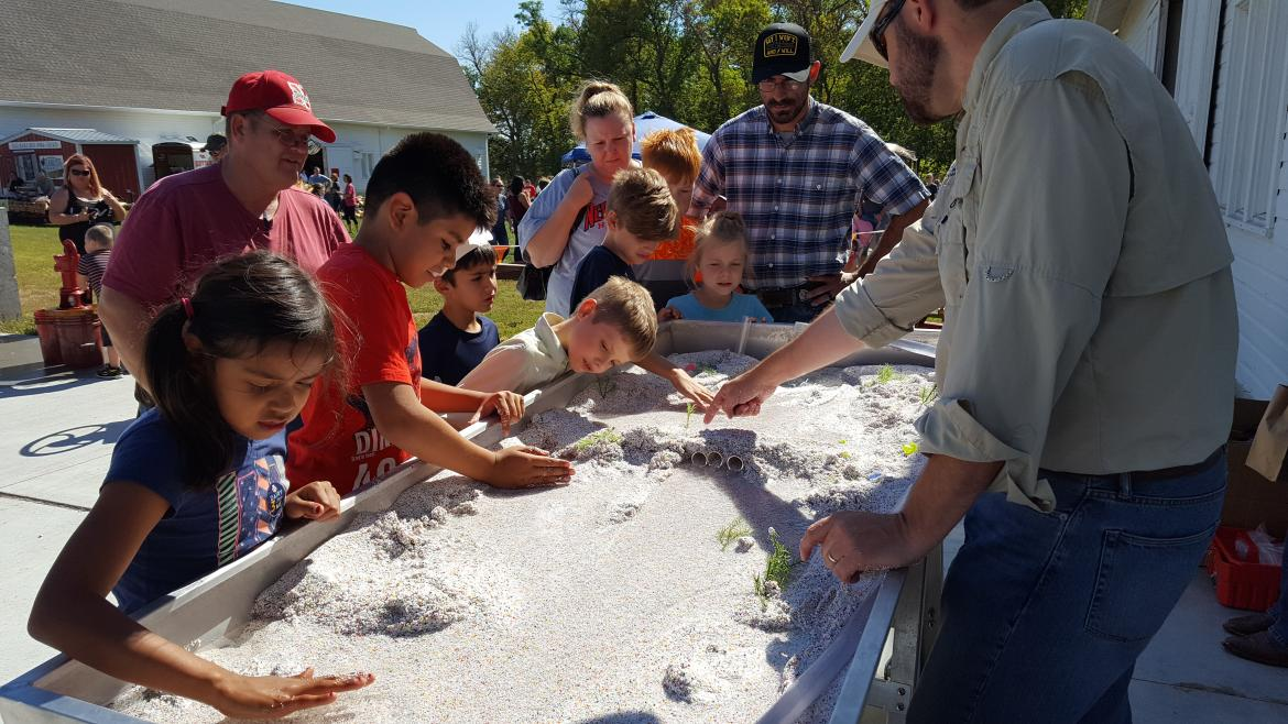 Children play in the sand with the Platte River Recovery Implementation Program on October 2, 2016.