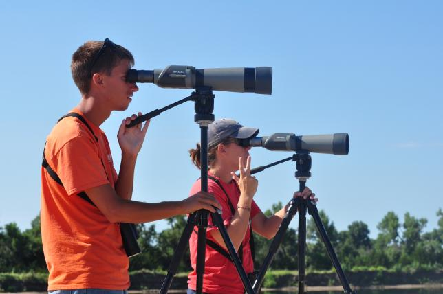 Platte River birders looking through spotting scopes